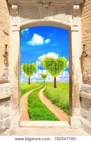Frame with ancient door and road, heart shape trees on green field