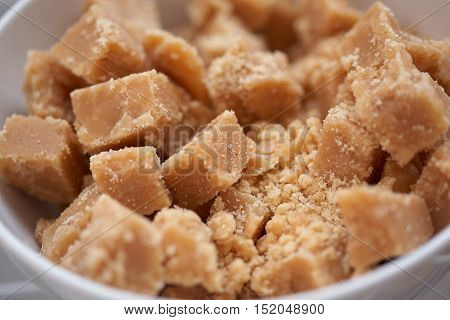 Dairy homemade toffee are in a white bowl