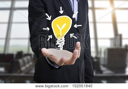 businessman with lightbulb concept inspiration or idea brainstorming.