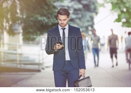 Lawyer  using smart phone on the street