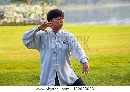 Bangkok, Thailand - February 13 2016: Unidentified Group Of People Practice Tai Chi Chuan In A Park