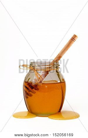 Delicious Sweet Honey With Dipper In Glass Jar.