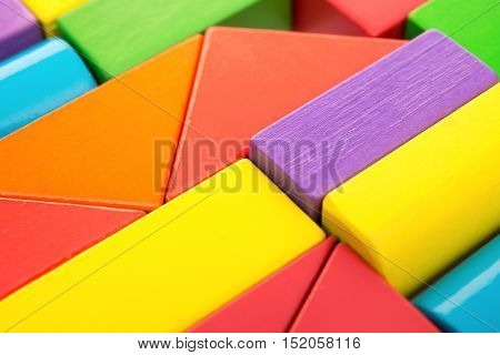 different color and shape wooden toy blocks