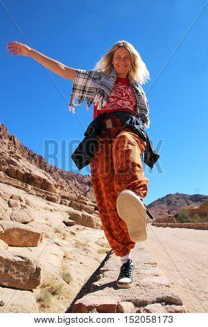 The woman walking in Sinai mountain. Travel concept
