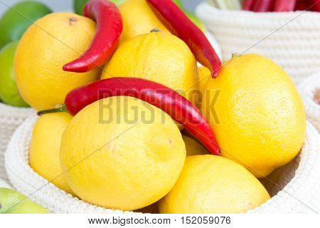 Lemons And Chili Peppers In A Wicker Basket Close-up