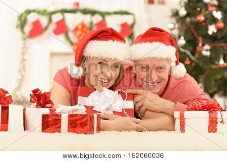 Amusing old couple wearing Christmas holiday caps
