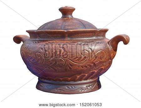 Beautiful tureen decorated with ornaments - handmade pottery clay in natural sunlight. Isolated on a white background