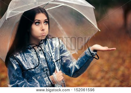 Woman with Transparent Raincoat and Umbrella Checking for Rain