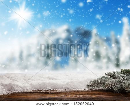 Empty wooden planks with blur snowy background. Ideal for product placement