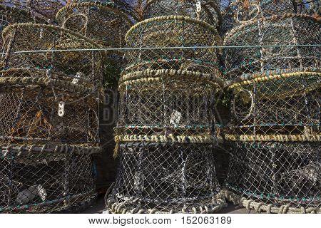 Lobster pots at Brixham harbour, Devon, England