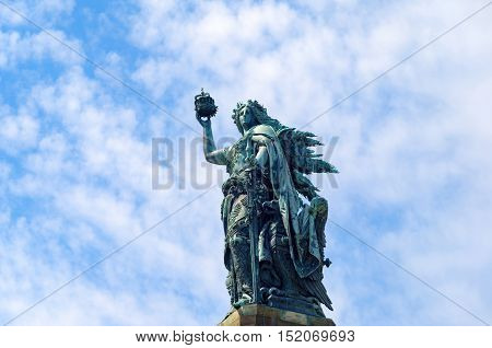 Bronze sculpture: Germania figure holding the crown of the emperor and the imperial sword - a part of the monument Niederwalddenkmal which represents the unification of Germany after the end of the Franco-Prussian War
