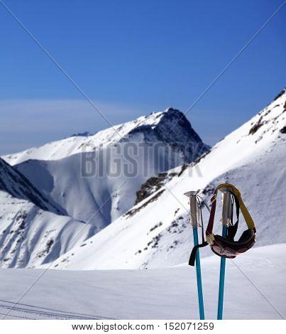 Ski Mask On Ski Poles And Off-piste Slope