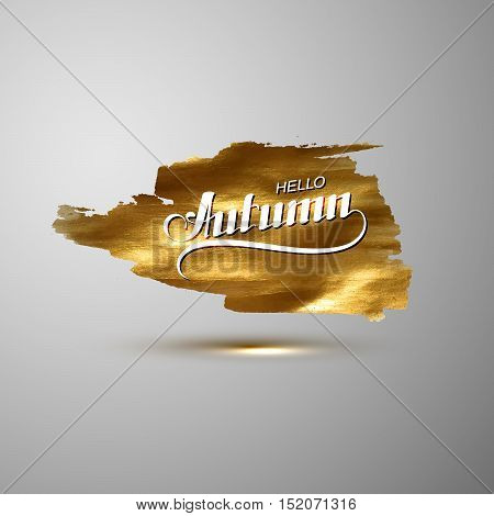 Hello Autumn. Seasonal vector illustration of handwritten label on golden paint stain banner. Vector gold paint. Autumn lettering composition with gold glittering textured stain.
