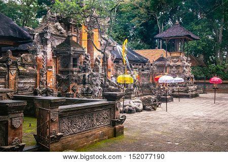 Buddhist temple stupa in tropical jungle of the Sacred Monkey Forest Sanctuary, Ubud, Bali, Indonesia. Asia landmark