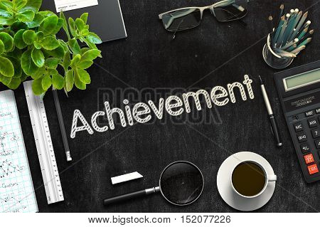 Top View of Office Desk with Stationery and Black Chalkboard with Business Concept - Achievement. 3d Rendering. Toned Image.