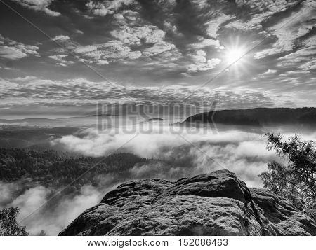 Exposed Sandstone Cliff Above Deep Misty Valley. Landscape View.