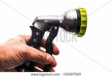 Hand Holding A Water Hose Sprinkler With Adjustable Shower Spray.