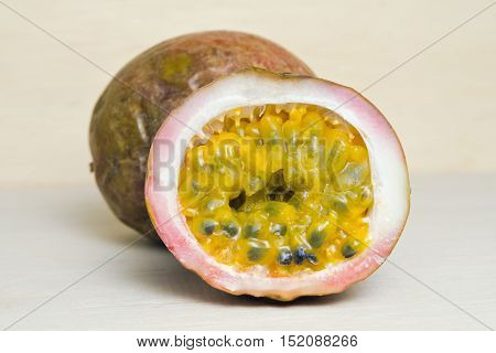 Passion fruit (also named as Passiflora edulis granadilla in Spanish granadille in French maracuja in Protuguese passion fruit in English and liliko I in Hawaiin) isolated on white background