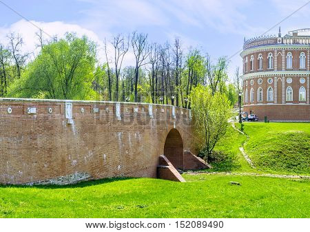 MOSCOW RUSSIA - MAY 10 2015: The Small Bridge over the ravine in Tsaritsyno Imperial Residence connects the greenhouses with the Bread House (Royal Kitchen) on May 10 in Moscow.