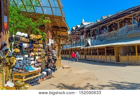 MOSCOW RUSSIA - MAY 10 2015: The fur hats are traditional presents from Russia many stalls of Izmailovsky market offers wide range of this type of accessories on May 10 in Moscow.