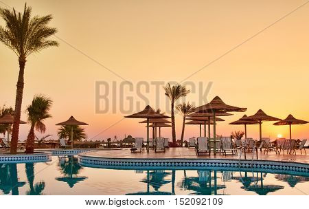 Swimming Pool With Palm Trees At Morning. Egypt