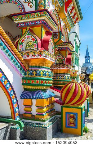 The richly decorated porch pillars and sculptures include fretwork and painted details with predominantly floral patterns Izmailovsky Kremlin Moscow Russia.