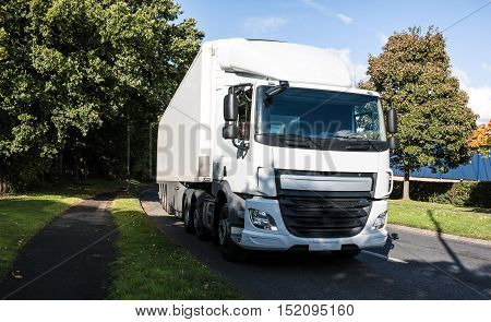 White lorry, heavy goods vehicle on the road