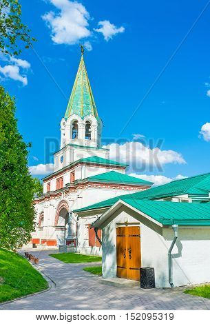 The bell tower above the Front Palace Gate in Kolomenskoye Manor with Colonel and Decrees Chambers from its both sides Moscow Russia.