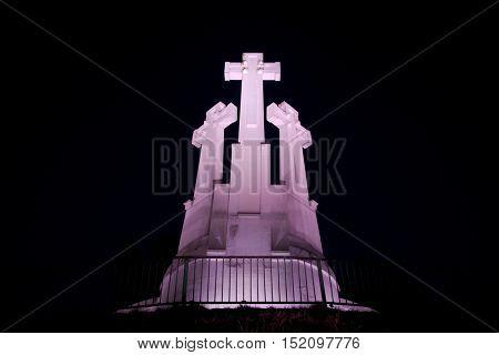 Three crosses illuminated in the night