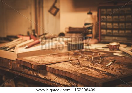 Close-up of the restorer worktable in his workshop