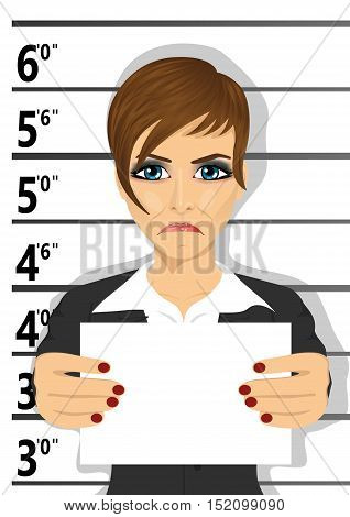Arrested businesswoman posing for a mugshot holding a signboard