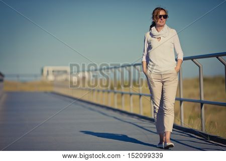 Woman walking at seaside