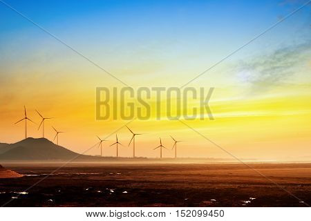Stretch as far as eye can see the grass and the horizon distance wind turbine.