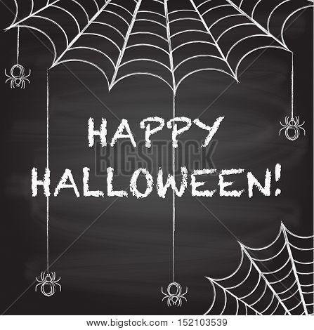 black chalkboard background with spider webs and spiders hanging down web. Happy halloween written in chalk hand drawn. Halloween card design