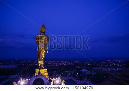 Buddha Image at Phra That Khao Noi temple after sunset in Nan northern province of Thailand.