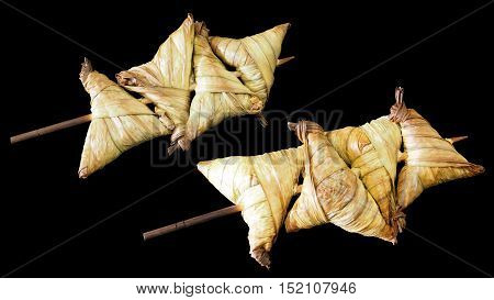 Dessert of Thailand Muslim Made of boiled cassava cooked steamed and then dried in the sun. Toss with the sugar then fried to crispy braised harden out side is Licuala water tube to wrapped.