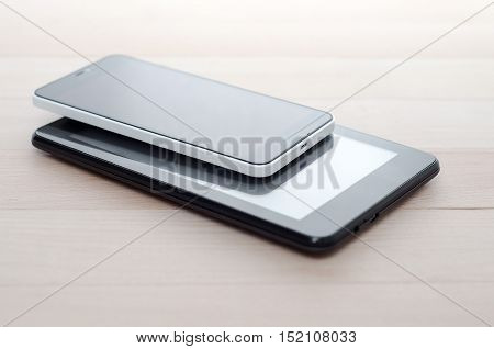Electronic devices on wooden table close up