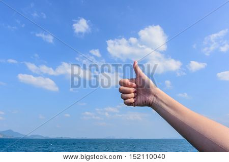 Close up thumb with sky clouds , abstract