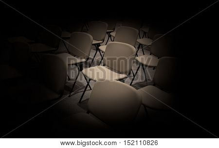 Empty Chairs in convention hall and black around background