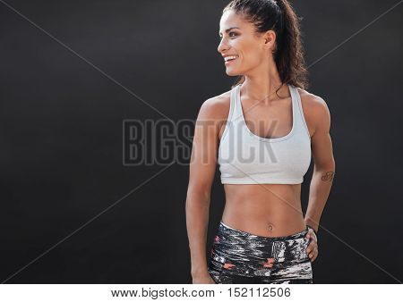 Happy Young Woman In Sports Clothing Smiling