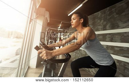 Cardio workout in gym by beautiful female