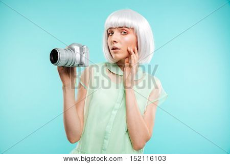Portrait of woman fashion photographer with modern photo camera