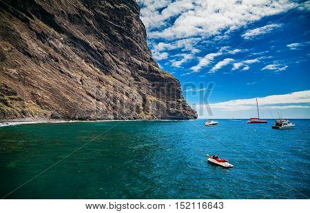ocean and cliffs at Playa de Masca at the end of the popular Gorge walk Tenerife Canary islands Spain