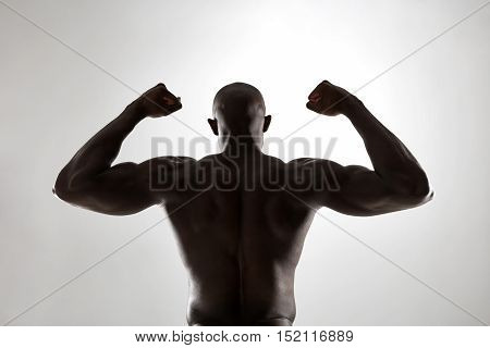 Muscular Man's Back In Silhouette