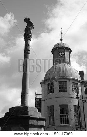 A view of the Mercat cross and domed clock tower in Cupar