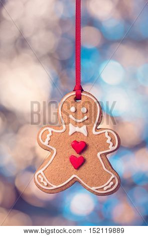 Gingerbread man hanging with shallow depth of field bokeh background