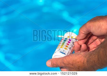 Man checking  the Ph of a private swimming pool