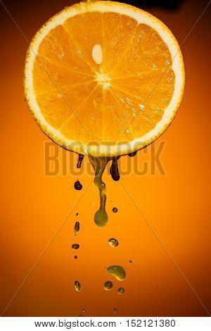 One half of orange isolated on colorful background