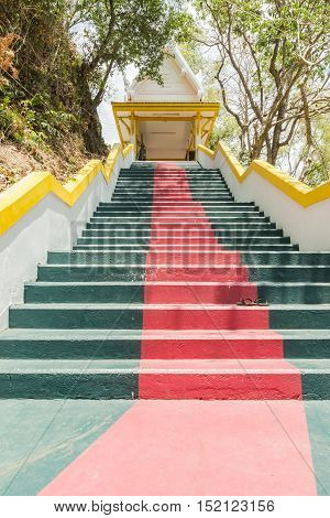 Phuket Thailand - April 25 2016 : The main stair leading to the replica of Phra That In-Kwaen (Hanging Golden Rock) at Sirey temple Phuket Thailand. poster