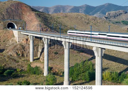 view of a high-speed train crossing a viaduct in Purroy, Zaragoza, Aragon, Spain. AVE Madrid Barcelona. poster